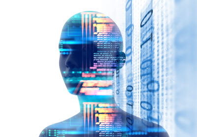 Image of a person's head with code over-layed to symbolize artificial intelligence